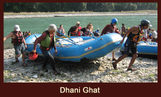 Paddling through the river point at Dhani Ghat during the Sunkoshi River Rafting in Nepal.