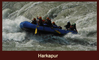 Paddling through the river point at Harkapur during the Sunkoshi River Rafting in Nepal.