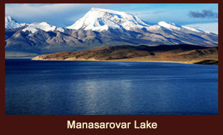 The holy Manasarovar Lake in Tibet is poised against the holy backdrop of Mt. Kailash.