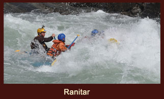 Paddling through the river point at Ranitar during the Sunkoshi River Rafting in Nepal.