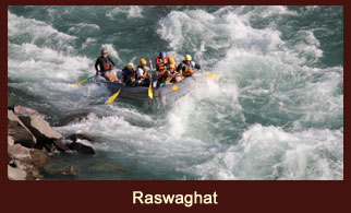 Paddling through the river point at Raswaghat during the Sunkoshi River Rafting in Nepal.