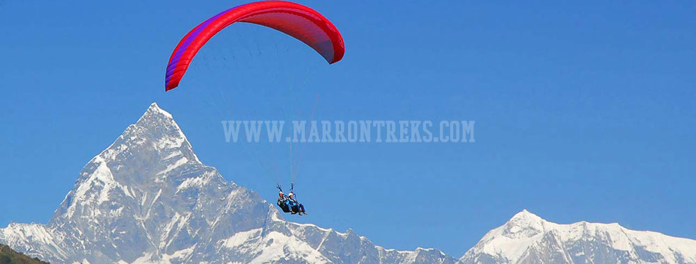Paragliding, a popular air adventure offered in Nepal at a tranquil town hamlet of Sarangkot.