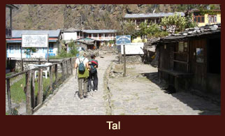 Tal, a small village situated against the backdrop of a beautiful waterfall in the Annapurna region of Nepal.